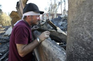 A resident looks at the ruins of his bedroom after the Colby Fire in Glendora, California